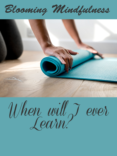 Picture is the name of the blog written above a woman out of frame we see only her hands as she rolls up a bright teal coloured yoga mat with the title of the article written below